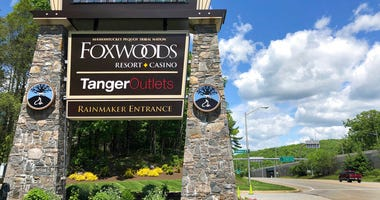 A sign at the entrance to the Foxwoods Resort Casino, in Mashantucket, Conn., announces its reopening, Monday, June 1, 2020.