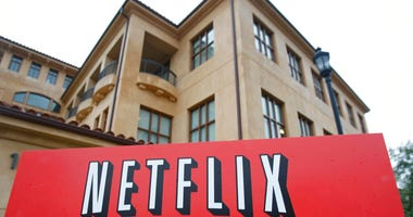 FILE - This Jan. 29, 2010, file photo shows the company logo and view of Netflix headquarters in Los Gatos, Calif.  (AP Photo/Marcio Jose Sanchez, File)