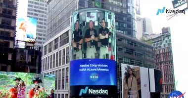 - This image from video made available by NASA shows a live video of astronaut Chris Cassidy, right, ringing the opening bell of the Nasdaq Stock Exchange from the International Space Station, accompanied by fellow astronauts Robert L. Behnken, left, and