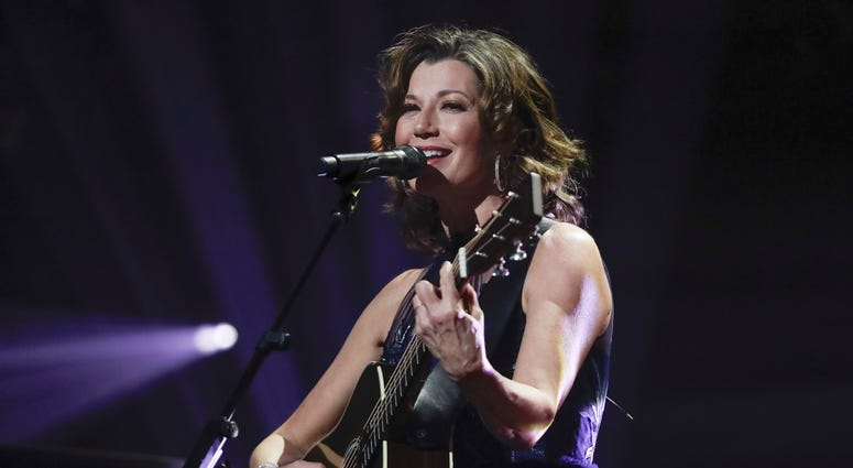 FILE - In this Oct. 15, 2019 file photo, singer Amy Grant performs during the Dove Awards in Nashville, Tenn.