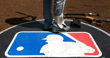FILE - In this April 24, 2013, file photo, Cleveland Indians second baseman Jason Kipnis stands on the Major League Baseball logo that serves as the on deck circle during the first inning of a baseball game between the Chicago White Sox and the Indians, i