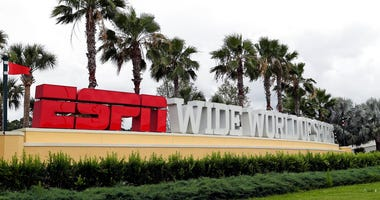 A sign marking the entrance to ESPN's Wide World of Sports at Walt Disney World is seen Wednesday, June 3, 2020, in Kissimmee, Fla.