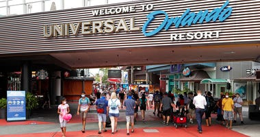 In this Wednesday, June 3, 2020 photo, visitors arrive at Universal Studios Wednesday, June 3, 2020, in Orlando, Fla.