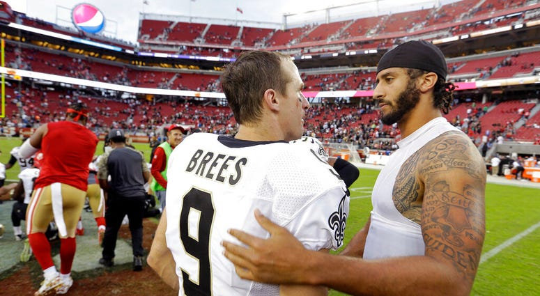 FILE - In this Nov. 6, 2016, file photo, San Francisco 49ers quarterback Colin Kaepernick, right, is greeted by New Orleans Saints quarterback Drew Brees at the end of an NFL football game in Santa Clara, Calif.