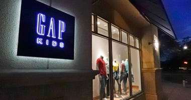 FILE - This Aug. 23, 2018, file photo shows a window display at a Gap Kids clothing store in Winter Park, Fla. Gap is being sued for refusing to pay rent for stores temporarily closed during the coronavirus pandemic.