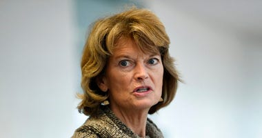 "FILE - In this March 19, 2020, file photo Sen. Lisa Murkowski, R-Alaska, talks with reporters following a Republican policy lunch on Capitol Hill in Washington. Murkowski acknowledged Thursday, June 4, that she's ""struggling"" over whether she can support"