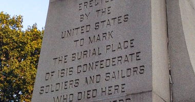 File-This Aug. 15, 2017, file photo shows an inscription on a monument in Garfield Park of Indianapolis dedicated to Confederate soldiers who died at a Union prison camp in the city during the Civil War.
