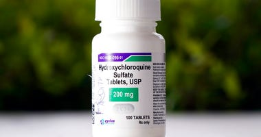 FILE - This April 7, 2020 file photo shows a bottle of hydroxychloroquine tablets in Texas City, Texas.