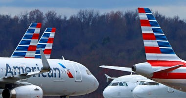 FILE - In this March 31, 2020 file photo American Airlines planes are parked at Pittsburgh International Airport in Imperial, Pa.