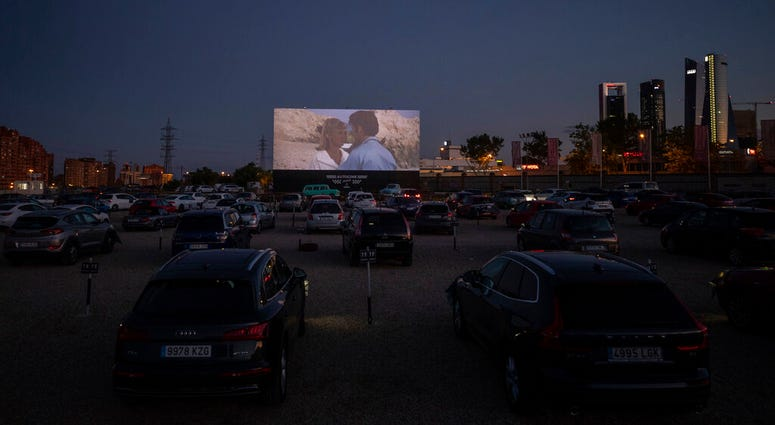 """Moviegoers watch the movie """"Grease"""" at the Autocine Madrid Race drive-in cinema during the coronavirus outbreak in Madrid, Spain, Thursday, June 4, 2020."""