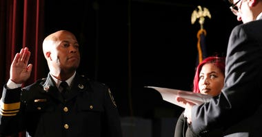 FILE - In this Sept. 8, 2017, file photo, newly appointed Minneapolis Police Chief Medaria Arradondo takes the oath of office as his daughter Nyasia looks on during a public swearing-in ceremony, in Minneapolis.