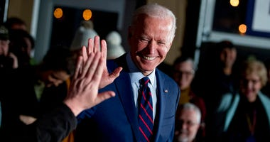 FILE - In this Jan. 5, 2020, file photo Democratic presidential candidate, former Vice President Joe Biden high-fives a member of the audience during a campaign rally at Modern Woodmen Park in Davenport, Iowa