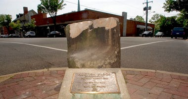FILE- This May 5, 2005, file photo, shows the historic pre-civil war auction block for slaves and property at the corner of Charles and William Streets in downtown Fredericksburg, Va.