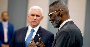 Bishop Harry Jackson gives thumbs up as he greets Vice President Mike Pence, left, who arrives to meet with community and faith leaders at Hope Christian Church, Friday, June 5, 2020, in Beltsville, Md.