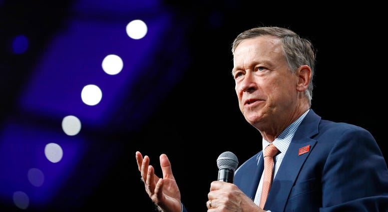 FILE - In this Aug. 10, 2019 file photo, then Democratic presidential candidate former Colorado Gov. John Hickenlooper speaks at the Presidential Gun Sense Forum in Des Moines, Iowa.