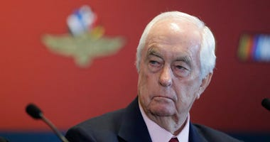 FILE - In this Jan. 15, 2020 file photo Indianapolis Motor Speedway owner Roger Penske listens during a news conference at the Indianapolis Motor Speedway in Indianapolis.