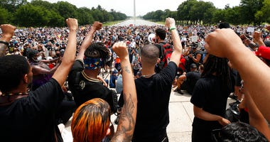 Demonstrators protest Saturday, June 6, 2020, at the Lincoln Memorial in Washington, over the death of George Floyd, a black man who was in police custody in Minneapolis.