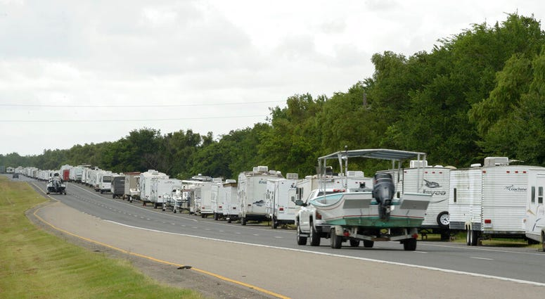Recreational trailers and boats are parked along LA-46 inside the levee gates in anticipation of Tropical Storm Cristobal in St. Bernard Parish, La., Saturday, June 6, 2020.