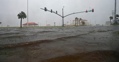 Storm surge covers US 90 in Long Beach, Miss., Sunday, June 7, 2020, on the Mississippi Gulf Coast ahead of Tropical Storm Cristobal's landfall.