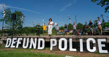 """Alondra Cano, a City Council member, speaks during """"The Path Forward"""" meeting at Powderhorn Park on Sunday, June 7, 2020, in Minneapolis. The focus of the meeting was the defunding of the Minneapolis Police Department."""