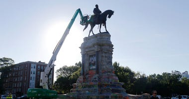 An inspection crew from the Virginia Department of General Services inspect the statue of Confederate Gen. Robert E. Lee on Monument Avenue Monday June. 8, 2020, in Richmond, Va.  (AP Photo/Steve Helber)