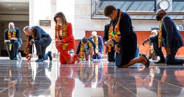 House Speaker Nancy Pelosi of Calif., center, and other members of Congress, kneel and observe a moment of silence at the Capitol's Emancipation Hall, Monday, June 8, 2020, on Capitol Hill in Washington. (AP Photo/Manuel Balce Ceneta)