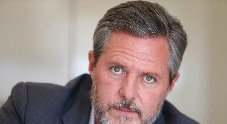 FILE - In this Nov. 16, 2016 file photo, Liberty University president Jerry Falwell Jr., poses during an interview in his offices at the school in Lynchburg, Va.