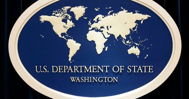 FILE - This Aug. 10, 2006, file photo shows the sign used as the backdrop for press briefings at the U.S. Department of State in Washington.