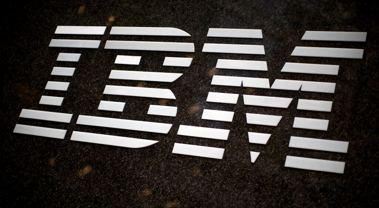 FILE- In this April 26, 2017, file photo, the IBM logo is displayed on the IBM building in Midtown Manhattan, in New York.  (AP Photo/Mary Altaffer, File)