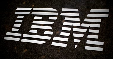 FILE- In this April 26, 2017, file photo, the IBM logo is displayed on the IBM building in Midtown Manhattan, in New York. IBM says it is getting out of the facial recognition business over concern about how it can be used for mass surveillance and racial