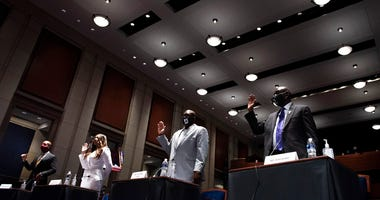 From left, Paul Butler, Angela Underwood Jacobs, Philonise Floyd, and Ben Crump are sworn in during a House Judiciary Committee hearing on proposed changes to police practices and accountability on Capitol Hill, Wednesday, June 10, 2020, in Washington.