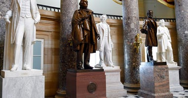 FILE - In this June 24, 2015 file photo, a statue of Jefferson Davis, second from left, president of the Confederate States from 1861 to 1865, is on display in Statuary Hall on Capitol Hill in Washington.