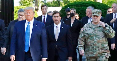 FILE - In this June 1, 2020 file photo, President Donald Trump departs the White House to visit outside St. John's Church, in Washington.
