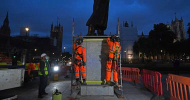 Scaffolders erect boarding around the statue of Sir Winston Churchill at Parliament Square, in London, Thursday, June 11, 2020, following Black Lives Matter protests that took place across the U.K. over the weekend.