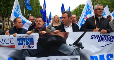 "French police unionists demonstrate with a banner reading ""No police, no peace"" down the Champs-Elysee avenue, Friday, June 12, 2020 in Paris."