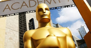 FILE - In this Feb. 21, 2015 file photo, an Oscar statue appears outside the Dolby Theatre for the 87th Academy Awards in Los Angeles.