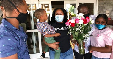 Teisha Roberts, center, a nursing director, is greeted by her family as she prepares to leave Park Springs elder care facility in Stone Mountain, Ga., Saturday, June 13, 2020.