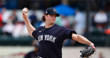 FILE - In this March 5, 2020, file photo, New York Yankees starting pitcher Gerrit Cole throws during a spring training baseball game against the Detroit Tigers in Lakeland, Fla.