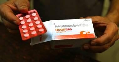 FILE - In this April 9, 2020 file photo, a chemist displays hydroxychloroquine tablets in New Delhi, India.