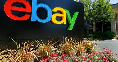 FILE - This Tuesday, July 16, 2013, file photo shows signage at eBay headquarters in San Jose, Calif. Six former eBay Inc. employees were arrested and charged Monday, June 15, 2020, with waging an extensive campaign to terrorize and intimidate the editor