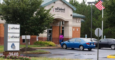 A customer walks out of the Call Federal Credit Union building Tuesday, June 16, 2020, in Midlothian, Va.