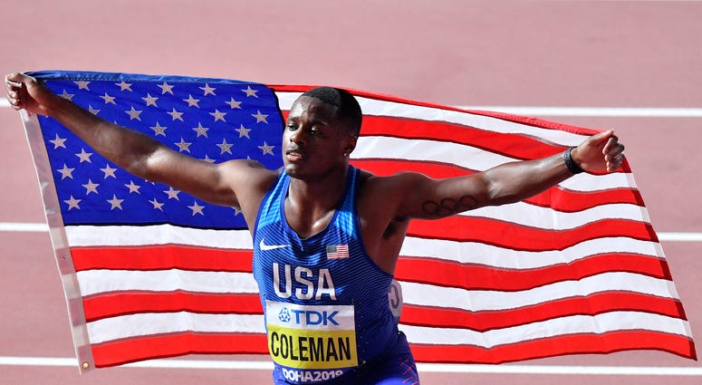 FILE - In this Sept. 28, 2019, file photo, Christian Coleman, of the United States, poses after winning the men's 100 meter race during the World Athletics Championships in Doha, Qatar.