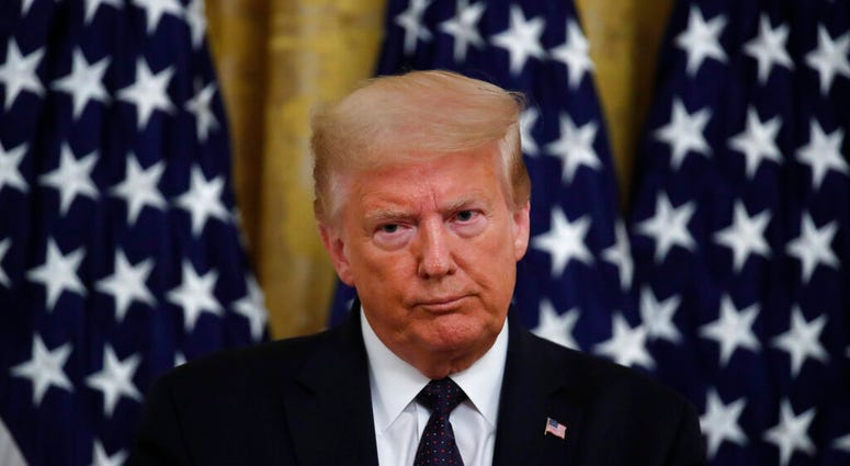"""President Donald Trump speaks about the PREVENTS """"President's Roadmap to Empower Veterans and End a National Tragedy of Suicide,"""" task force, in the East Room of the White House, Wednesday, June 17, 2020, in Washington."""