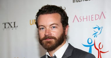 FILE - In this March 24, 2014 file photo, actor Danny Masterson arrives at Youth for Human Rights International Celebrity Benefit in Los Angeles.