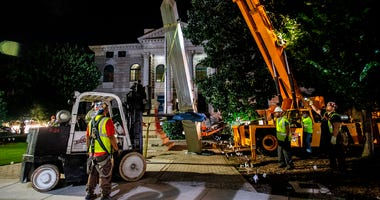 Workers remove a Confederate monument with a crane Thursday, June 18, 2020, in Decatur, Ga.