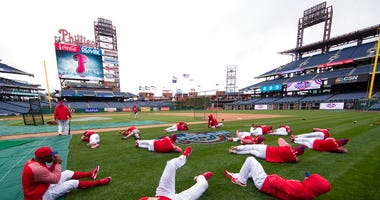 FILE - In this April 7, 2017, file photo, members of the Philadelphia Phillies stretch before the team's baseball game against the Washington Nationals in Philadelphia.