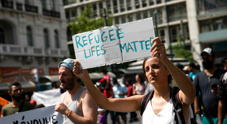 Protesters take part in a rally in favor of migrants who live in Greece, in Athens, on Saturday, June 20, 2020.
