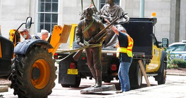 Crews add The Henry Wyatt Monument to a truck after removing them from the North Carolina State Capitol in Raleigh, N.C., Saturday, June 20, 2020.