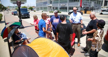 FILE - In this June 15, 2020, file photo Donald Trump supporters gather outside the BOK Center in Tulsa, Okla. Trump's campaign says six staff members helping set up for his Saturday night rally in Tulsa, Oklahoma, have tested positive for coronavirus.