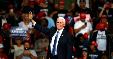 Vice President Mike Pence waves to the crowd during a campaign rally in Tulsa, Okla., Saturday, June 20, 2020.